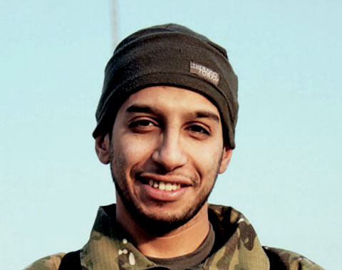 An undated file photograph of a man described as Abdelhamid Abaaoud that was published in the Islamic State's online magazine Dabiq and posted on a social media website. The suspected mastermind of the attacks that killed 129 in Paris was among those killed in a police raid in a suburb of the French capital, the Paris prosecutor said in a statement on Thursday. Abdelhamid Abaaoud, a 28-year-old Belgian militant, who had boasted of mounting attacks in Europe for the Islamic State, was accused of orchestrating Friday's coordinated bombings and shootings in the French capital, which killed 129 people. REUTERS/Social Media Website via Reuters TV/FilesATTENTION EDITORS - THIS PICTURE WAS PROVIDED BY A THIRD PARTY. REUTERS IS UNABLE TO INDEPENDENTLY VERIFY THE AUTHENTICITY, CONTENT, LOCATION OR DATE OF THIS IMAGE. FOR EDITORIAL USE ONLY. NOT FOR SALE FOR MARKETING OR ADVERTISING CAMPAIGNS. FOR EDITORIAL USE ONLY. THIS PICTURE WAS PROCESSED BY REUTERS TO ENHANCE QUALITY. TPX IMAGES OF THE DAY